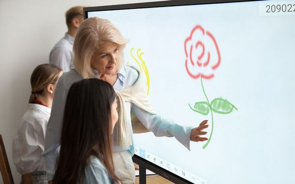 People using an interactive whiteboard